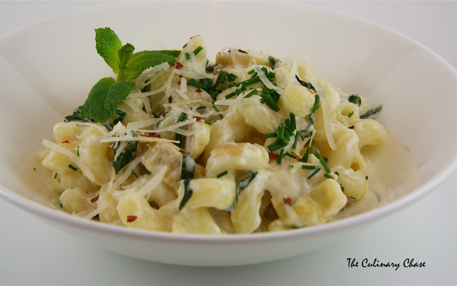 Cavatappi with Artichokes and Three Cheeses - The Culinary Chase