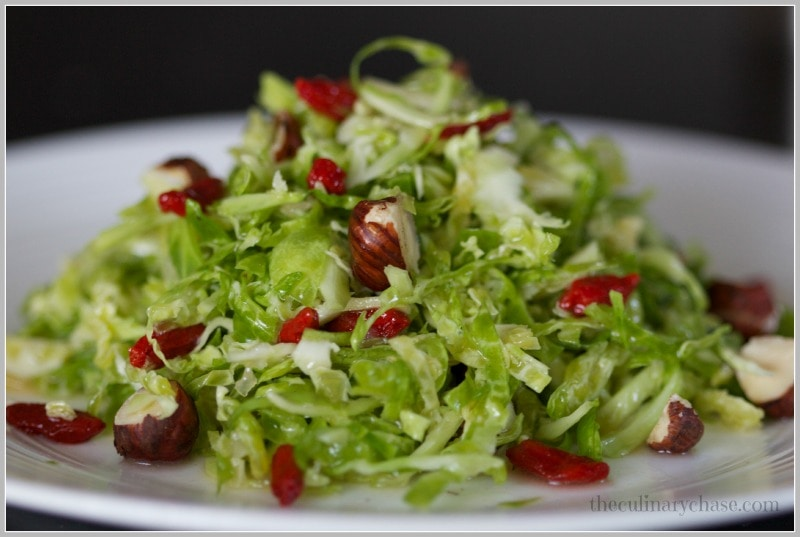 Brussels Sprout Salad with Garlic & Goji Berry Dressing