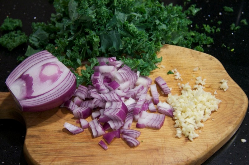 chopped kale, onions & garlic by The Culinary Chase