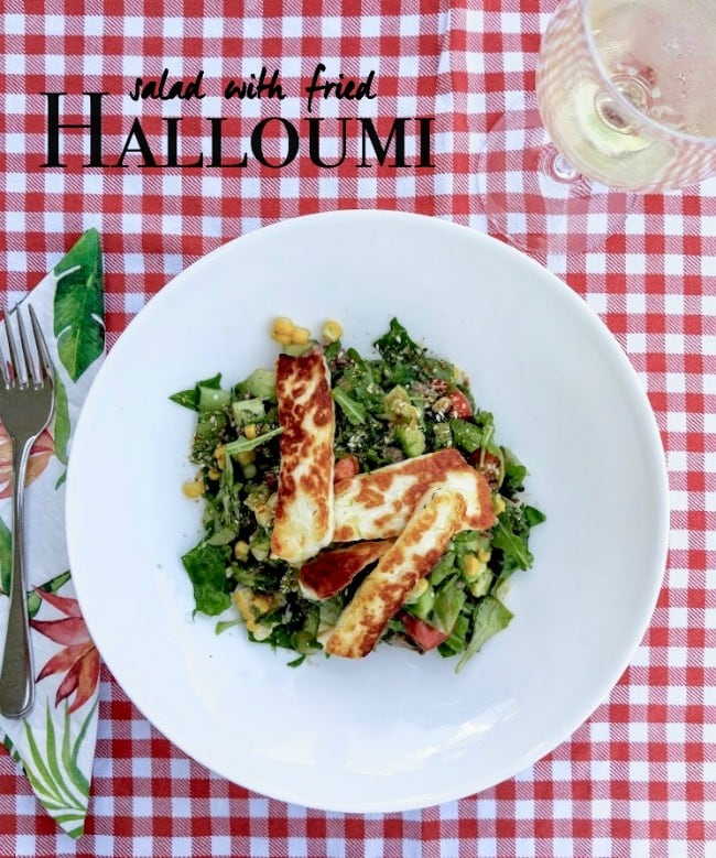 salad topped with fried halloumi
