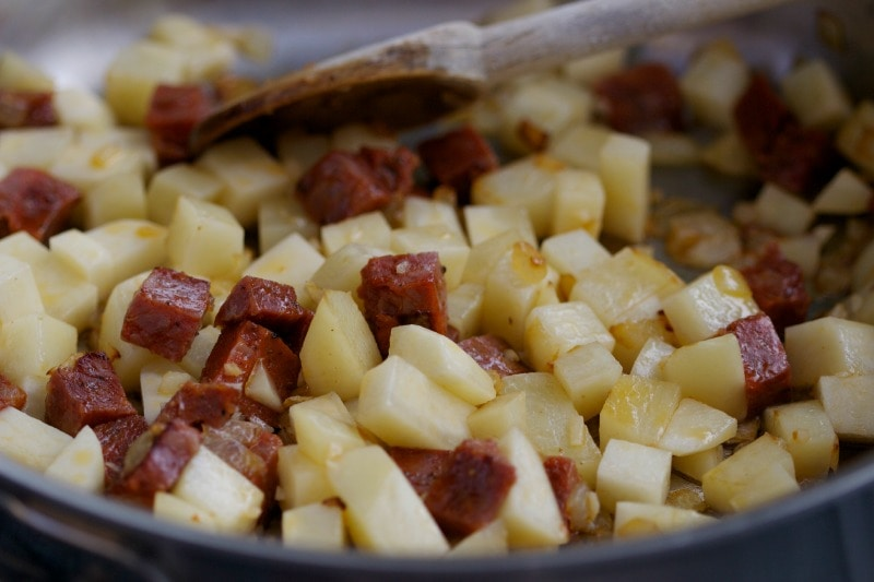 Spanish chorizo is made from coarsely chopped pork and pork fat, seasoned with smoked pimentón and salt.
