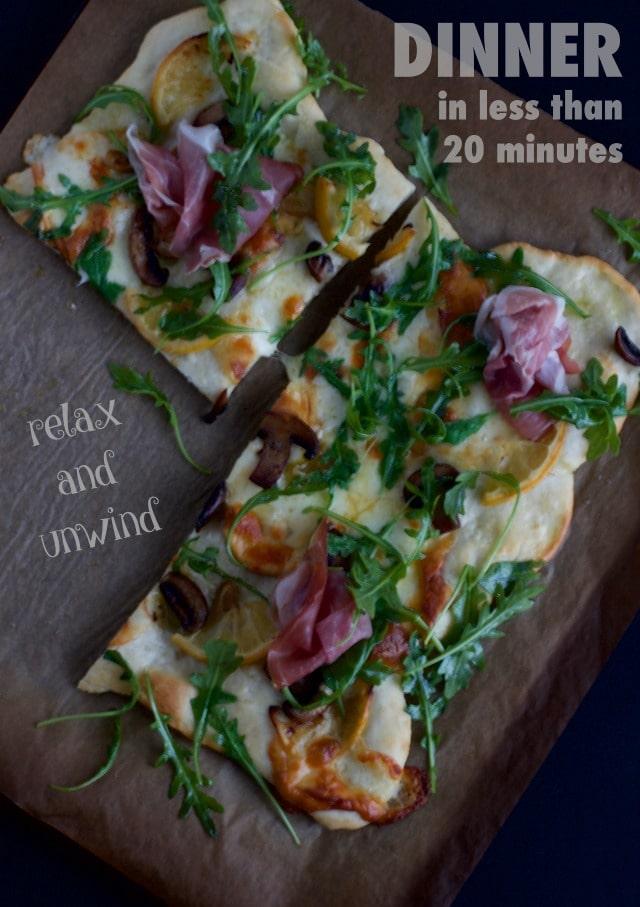 pizza with smoked mozzarella and lemon slices